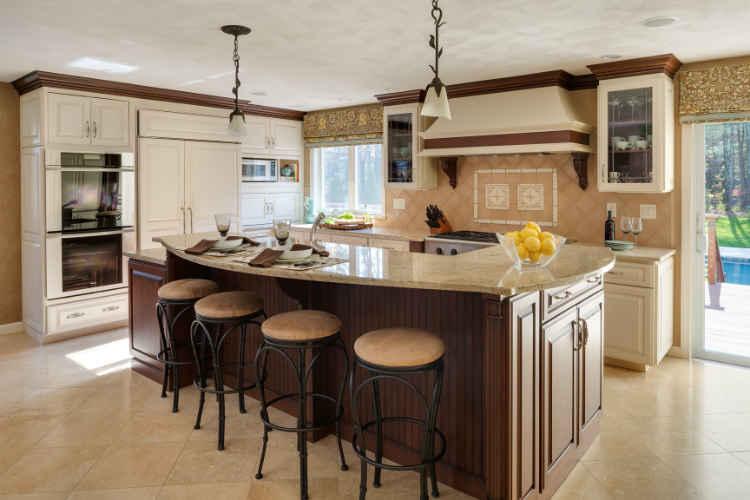 https://vivianrobinsdesign.com/wp-content/uploads/2019/10/beautiful-ivory-kitchen-with-large-island.jpg