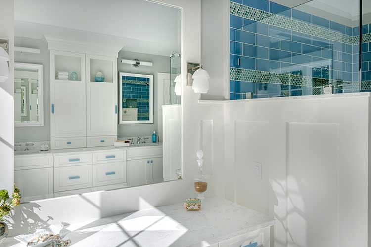 https://vivianrobinsdesign.com/wp-content/uploads/2019/10/white-bathroom-with-blue-accents-1.jpg