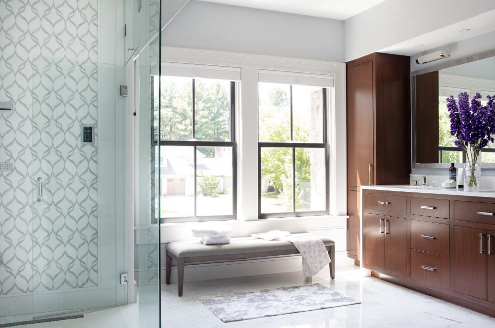 https://vivianrobinsdesign.com/wp-content/uploads/2020/10/vivian-robins-bathroom-interior-design-glass-shower-door-bench-seat.jpg