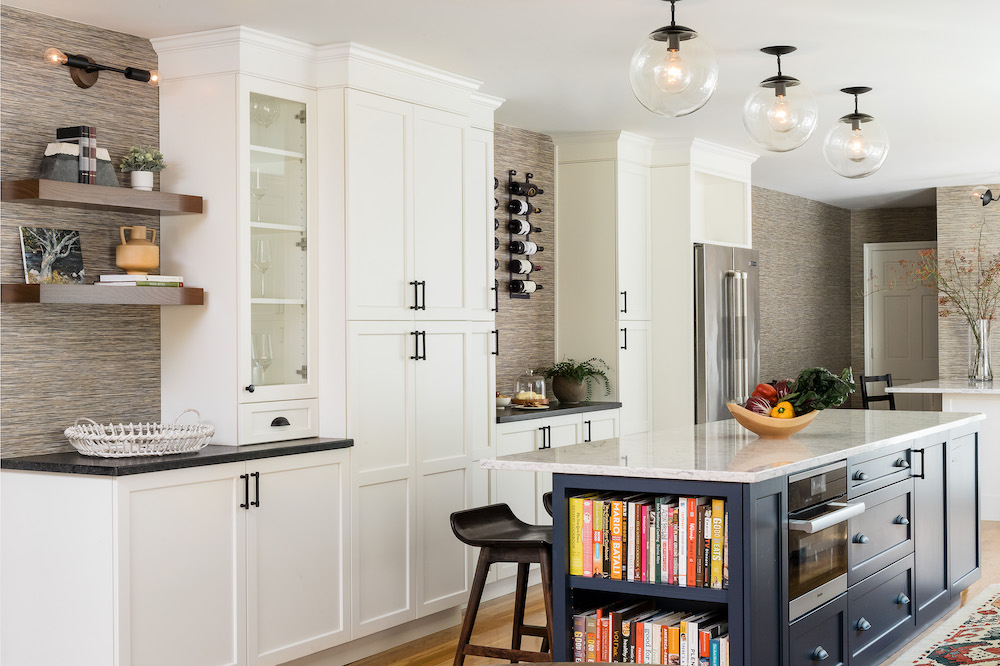 https://vivianrobinsdesign.com/wp-content/uploads/2021/08/kitchen-island-interior-design-cookbook-storage-open-shelves.jpg